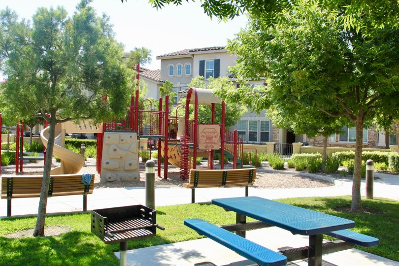 Houses overlook the lighted children's playground and picnic area at Savannah at Harveston in Temecula, California