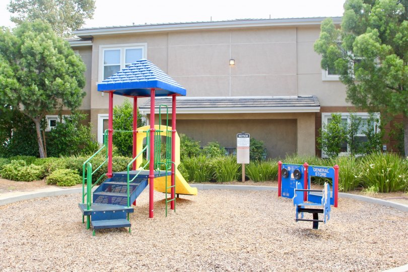 Playground for children with green grass and landscaping