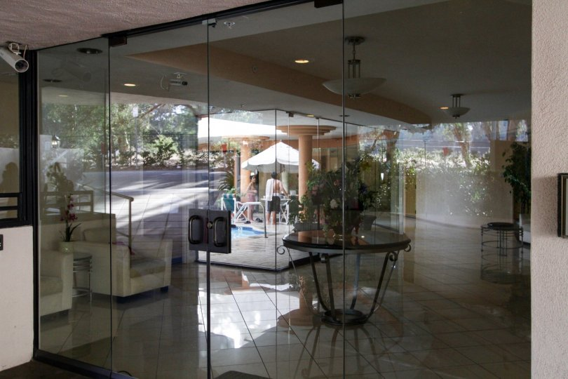 The glass doors leading into 450 N Maple Dr in Beverly Hills