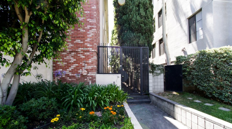 The gated side entrance of the Chateau Reeves in Beverly Hills