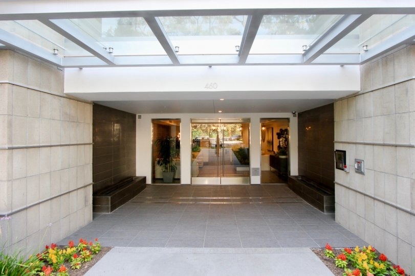 Entrance to Palm Condominiums with her classy details through the see through glass door, Beverly Hills, california