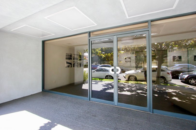 Cars in front of a glass door in 1120 Granville at sunny day