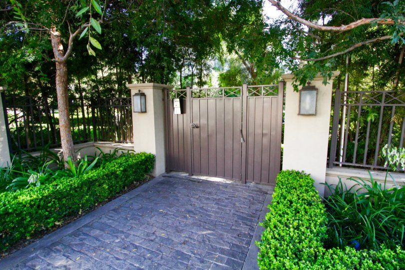 Cobblestones lead to the gated entry of Brentwood Garden Villas
