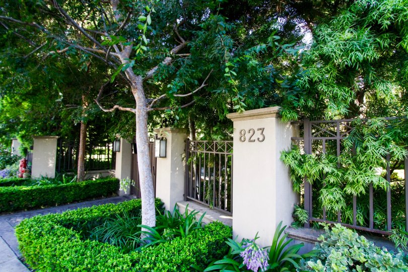 The Brentwood Garden Villas address number are mounted to a pillar