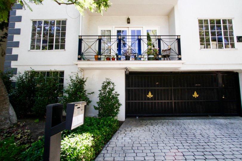 Cobblestones lead to a gated entrance to Fleur De Lis Brentwood