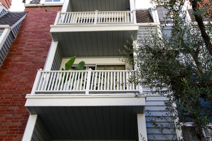 White wood railings on the Gorham Regency balconies