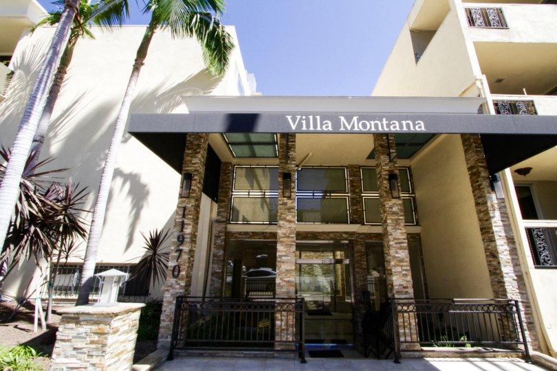 Large stone pillars rise to form the Villa Montana condo entry