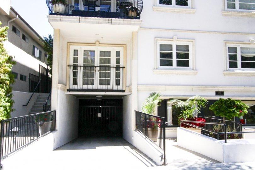 Private gated parking entrance to Villa Trocadero condos