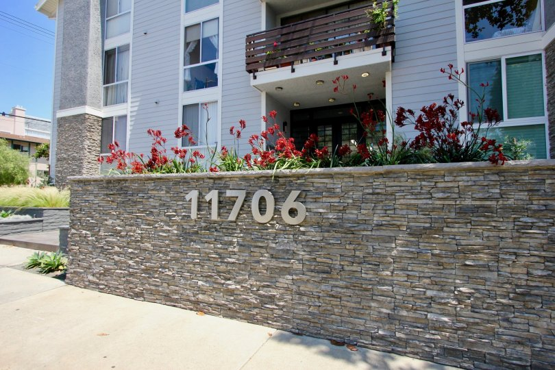 A luxurious apartment in Brentwood Cedar Tree with flowers out in front