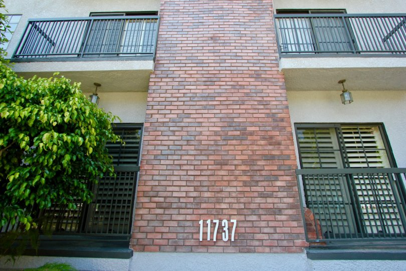 Brick wall separating balconies at 11737 in the Brentwood Royale community