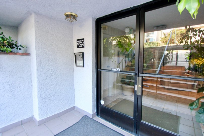 Glassy entrance of Brentwood Royale, Brentwood, California