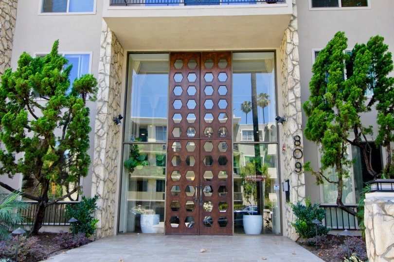 Beautifully ornate wood and glass entryway to Brentwood Sycamore in Brentwood California