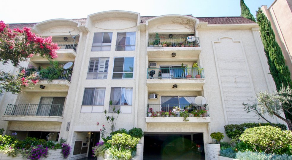 An apartment complex with multiple balconies and parking garage in Chateau Brentwood.