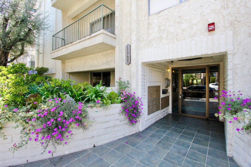 Classy entrance with super cool flowers of Chateau Brentwood Apartment, Brentwood, Calfornia