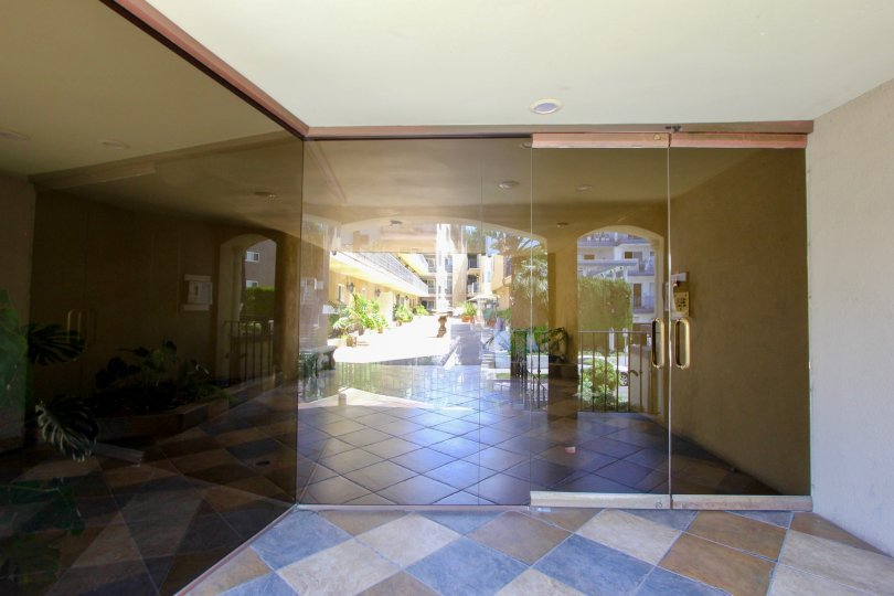Sun reflecting on the tiles and glass of the entrance to Chenault Villas in Brentwood, CA