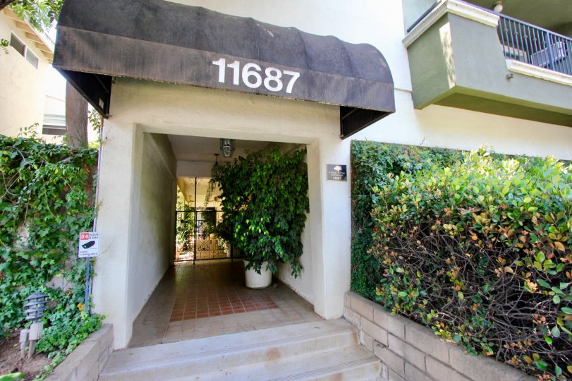 Looking at the front door of the Coral Tree apartments in Brentwood, California