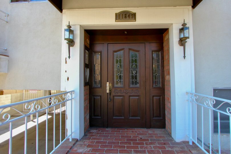 A View of the Front Door of Manor House Home in Brentwood