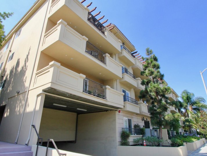 A street level view of an apartment building in the Mayfield Villa community in Brentwood, CA