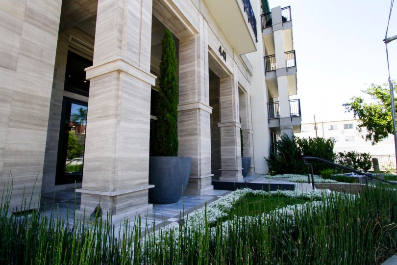 Beautifully landscaped planters cover the entrance to Cosmopolitan Brentwood