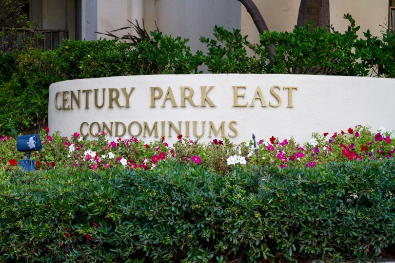 In gold letters on a raised planter is the Century Park East marquee