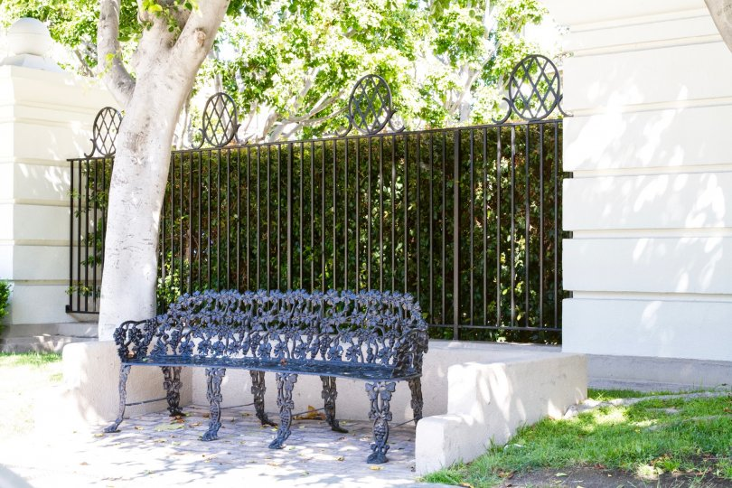 An ornate metal bench near the entrance to Le Parc