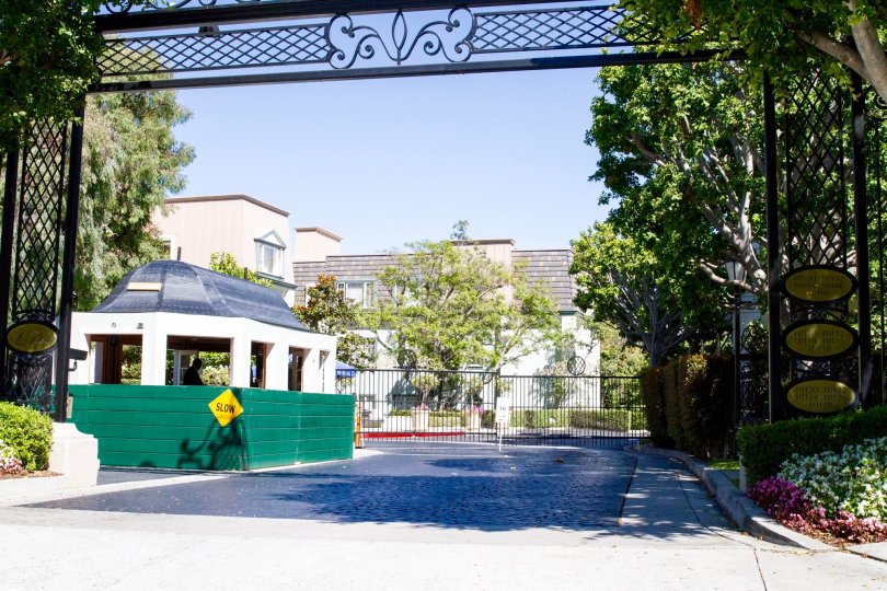 A large gated entrance to the condo community of Le Parc