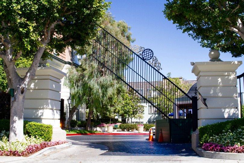A gate rises to let a car out of the Le Parc community