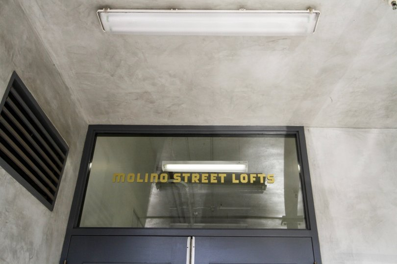 The name of Molino Street Lofts written above the door