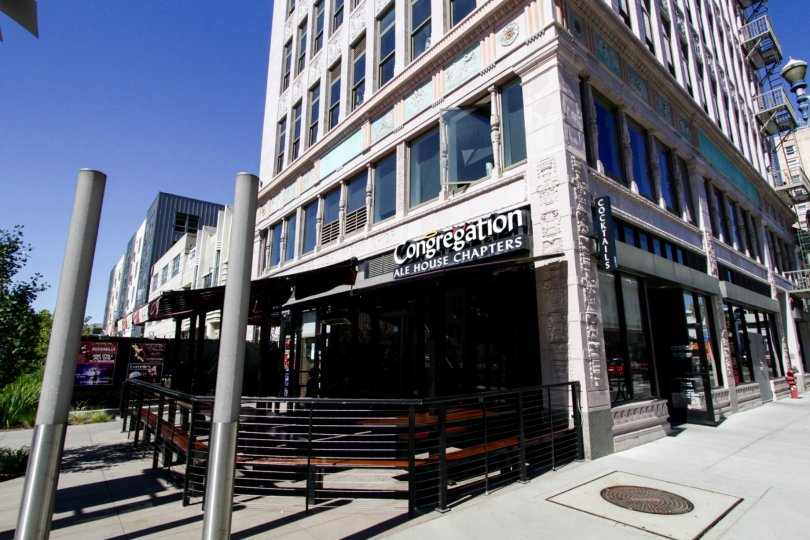 A restaurants occupies the corner of the first floor of Insurance Exchange Lofts building