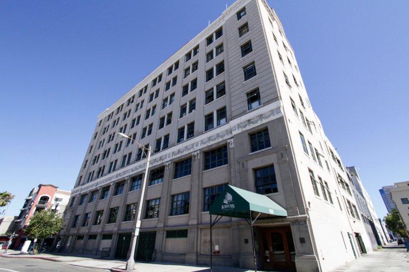 Kress Lofts is a grey condo building eight stories high
