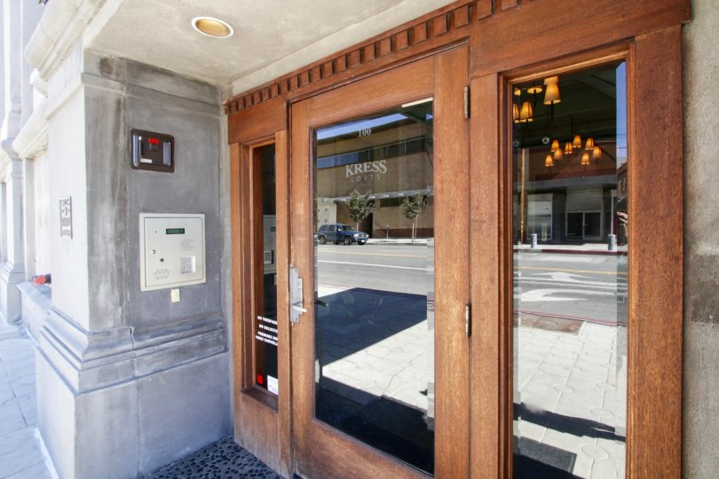 A wood door with glass insets leads to the entry to Kress Lofts