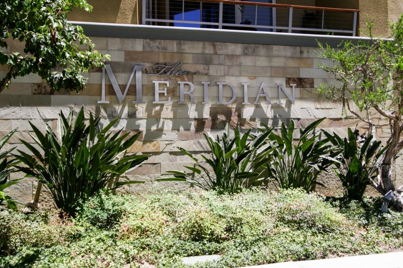 The Meridian marquee on a stone wall in front of the building