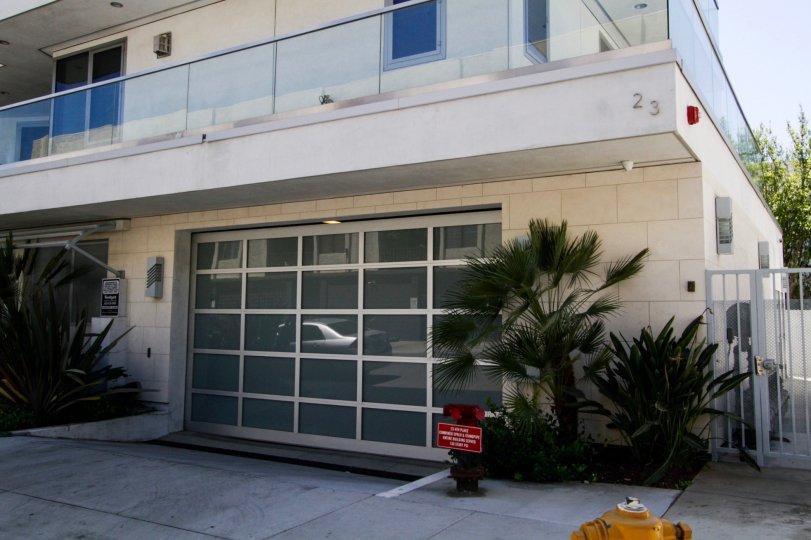 A frosted glass garage door at The Oceanside garage entrance