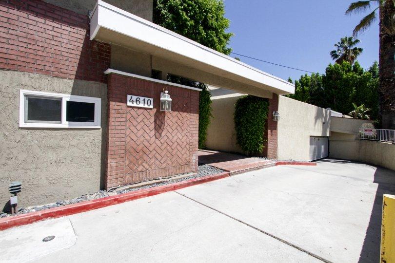 The gently sloping parking garage at 4610 Densmore Ave