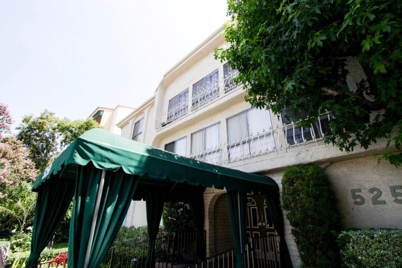 The shaded entrance to 5250 Zelzah Ave