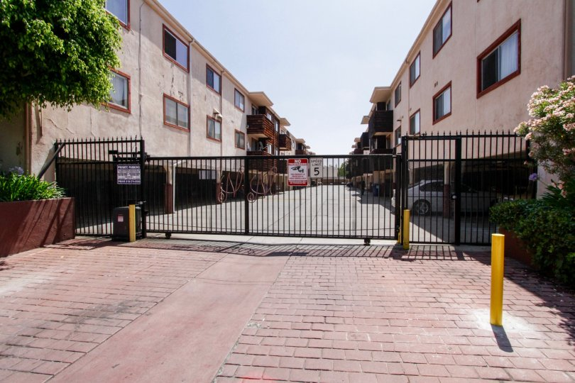 The gate going into the private parking of 5400 Newcastle Ave
