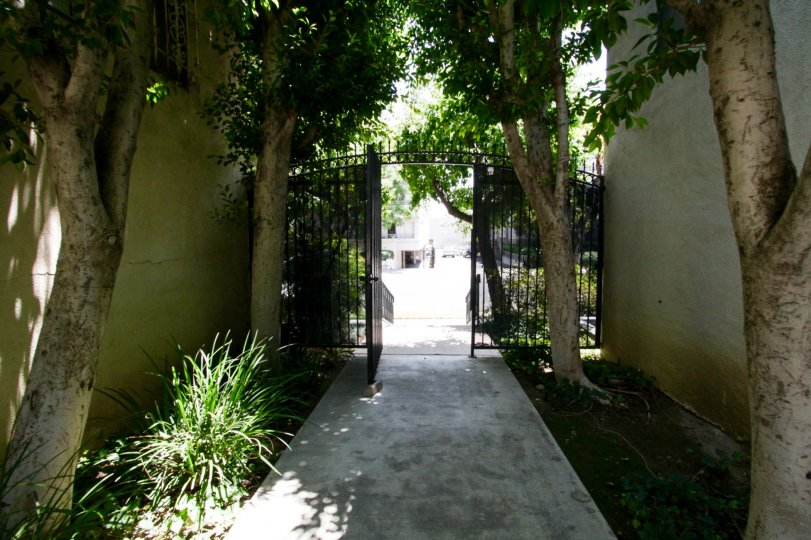 The gated entrance leading into the common area of Encino Gardens
