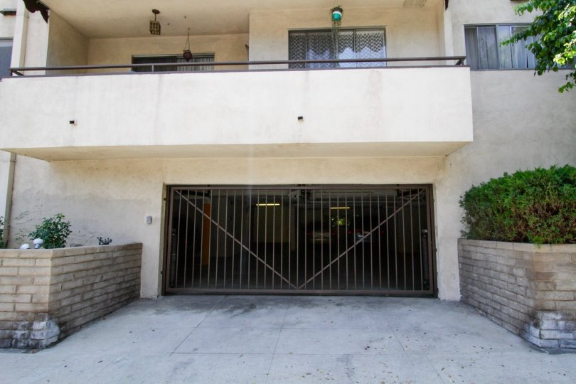 The gated parking area for the Encino Regency building