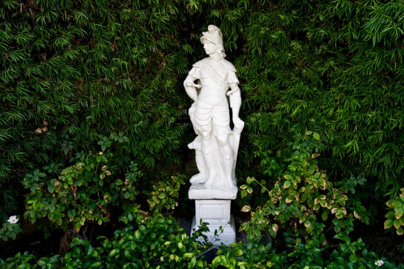 The statue among the landscaping at the Encino Spa