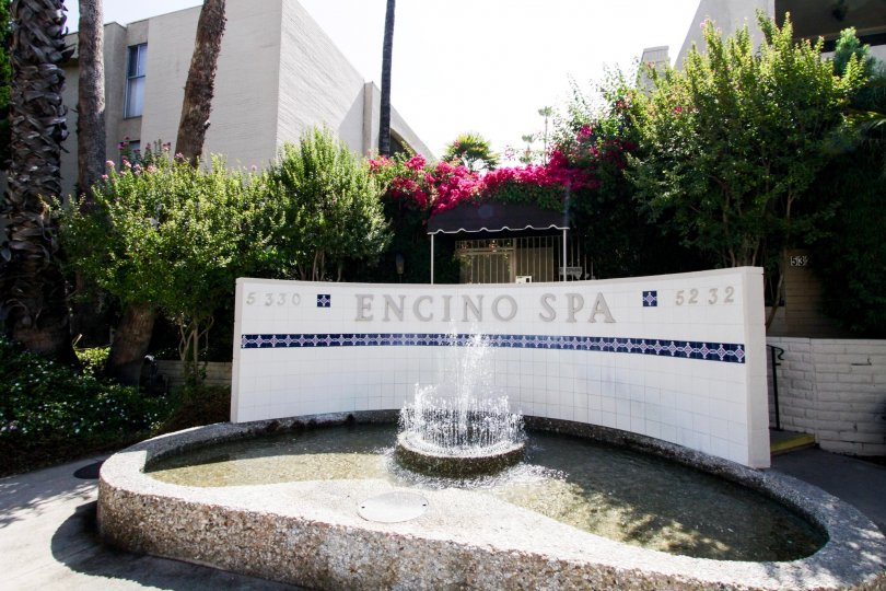 The sign along with fountain welcoming visitors to Encino Spa