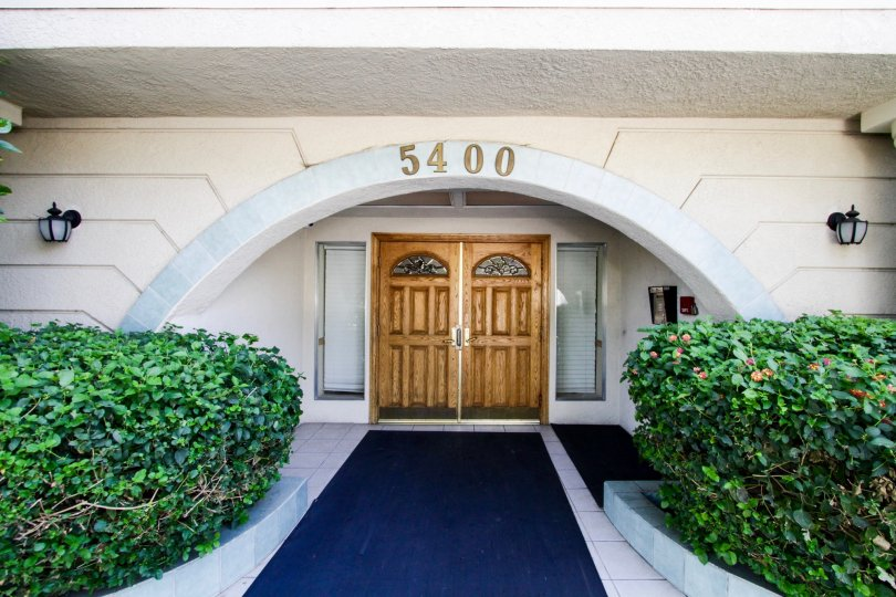 The double door entrance of the Ports of Call Condominiums