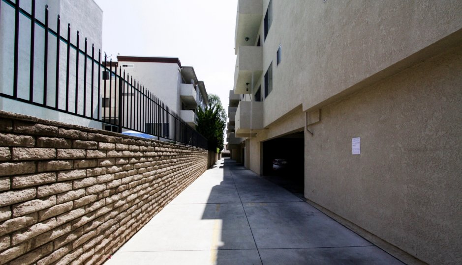 The breezeway between Ports of Call Condominiums buildings