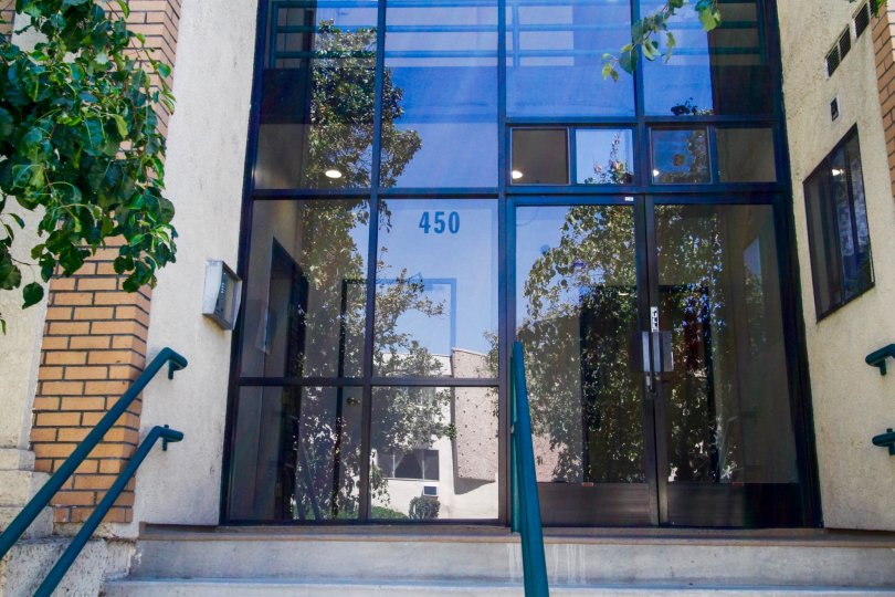 The address for Dryden Villas written on the windows