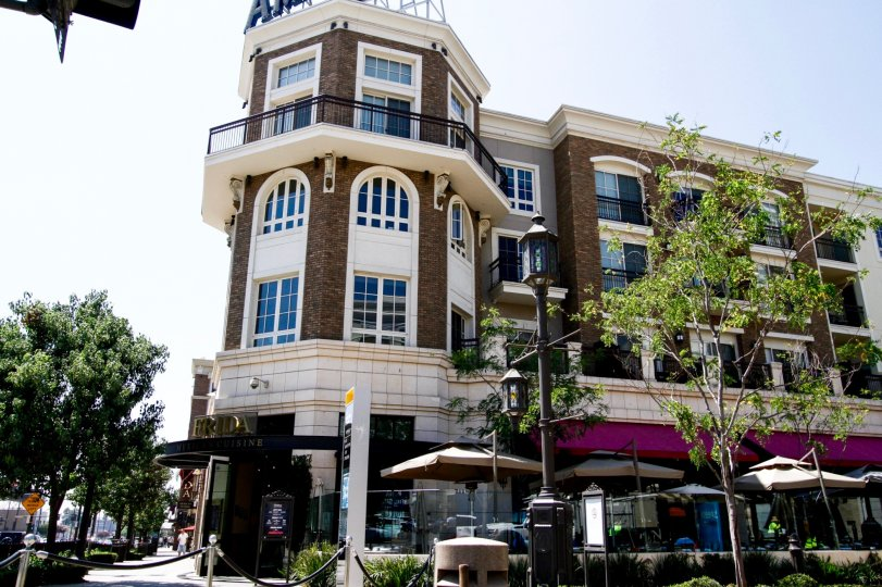 The patios out in front of Excelsior at Americana