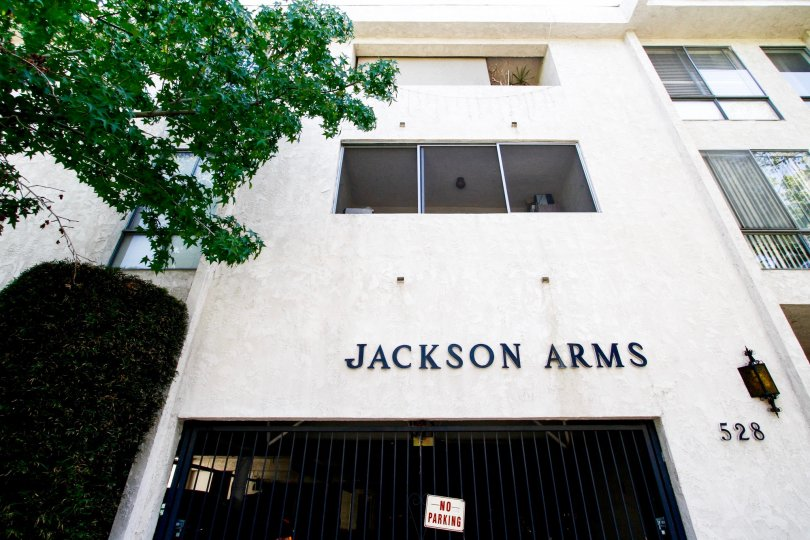 The name of Jackson Arms written on the building