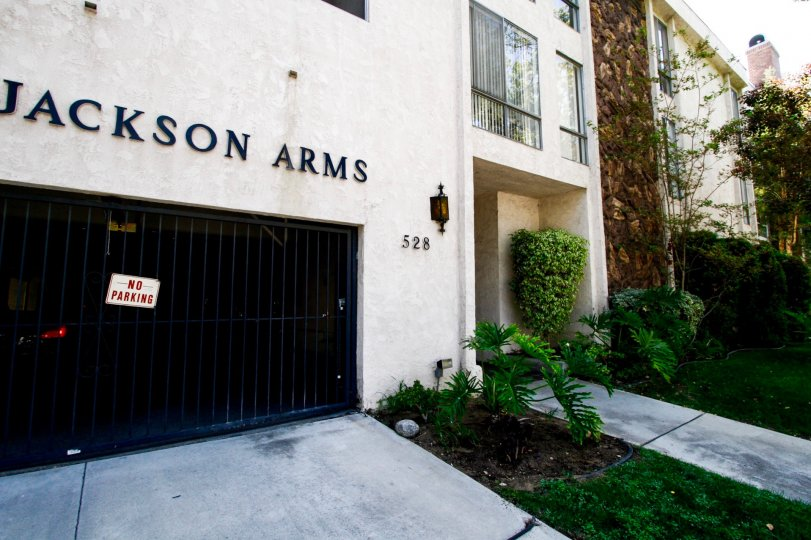 The address of Jackson Arms on the building