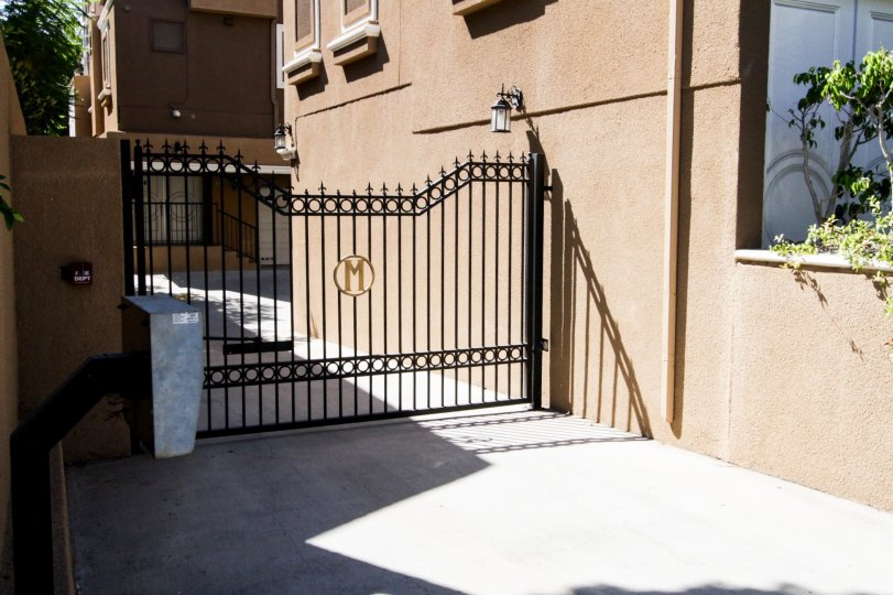 The side gate for Marbella Terraces West in Hancock Park