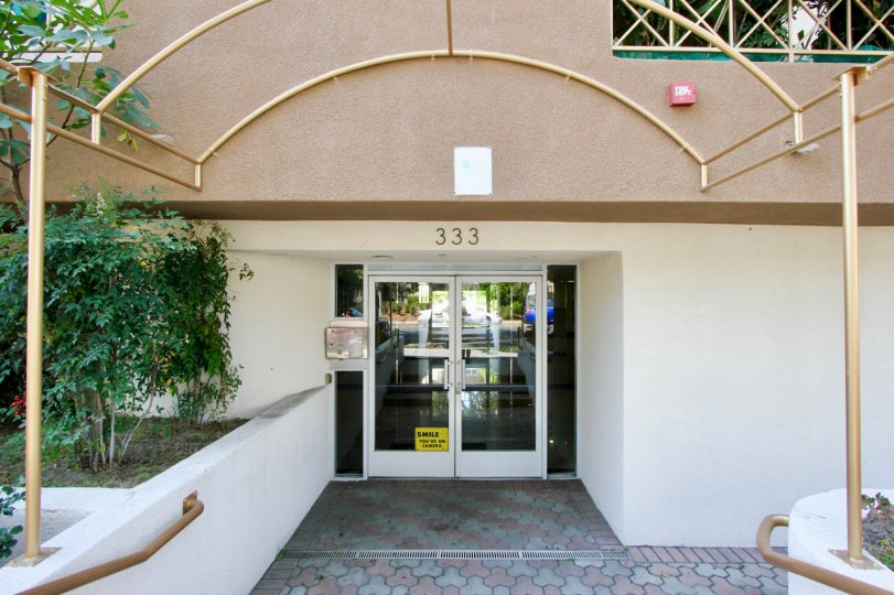 The front entrance of Westminster Village with glass doors closed