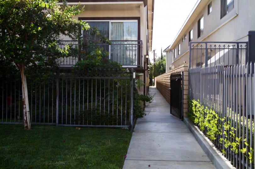 The sidewalk to the side of Wilton Gardens