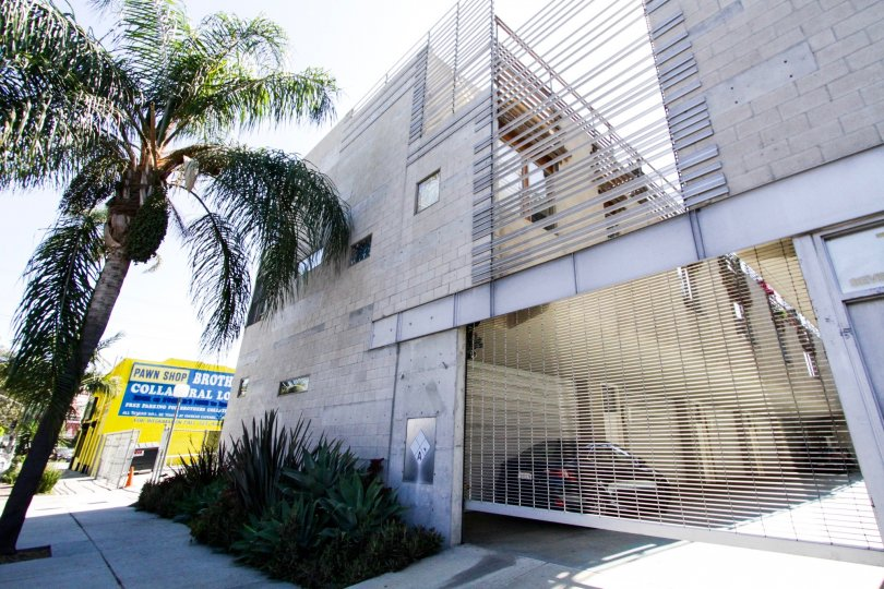 A gated entry leads to private garages and parking at Cahuenga Lofts